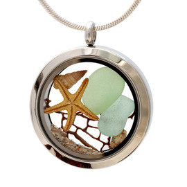 Genuine pale aqua and seafoam green sea glass combined with a vintage sea fan and real shells completed with real beach sand.