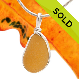 A once in a lifetime piece of large Golden Yellow sea glass is set in our Original  Wire Bezel© pendant setting in sterling silver. This setting leaves the sea glass just the way it was found on the beach in England. Sorry this sea glass jewelry piece has been sold!