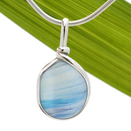 A stunning combination of pale blue and purple suspended in a white base in this very old English Sea Glass piece and set in our Original Wire Bezel© necklace pendant setting.