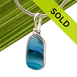 Beautiful stunning and petite sea glass piece from Seaham England set in a solid sterling setting Sorry this sea glass jewelry item has been sold!