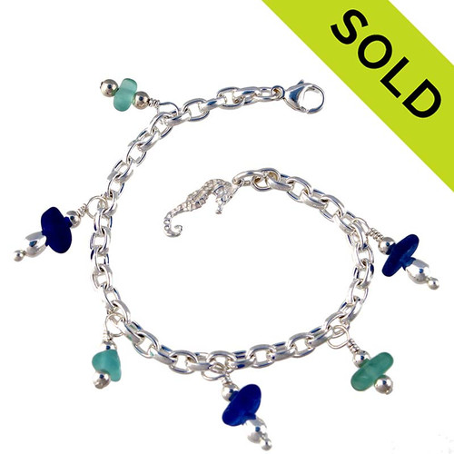 3 pieces of aqua and 3 Blue genuine beach found sea glass combined with solid sterling beach inspired charm in a totally solid sterling silver bracelet. SOLD - Sorry this Sea Glass Bracelet is NO LONGER AVAILABLE!
