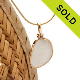 SOLD - Sorry this Sea Glass Pendant is NO LONGER AVAILABLE! A neat shaped piece of pure white sea glass in our Original Wire Bezel© necklace pendant in 14K Goldfilled setting.