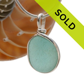A perfect piece of aqua blue sea glass in our Original Wire bezel© necklace pendant setting. Sorry this sea glass jewelry piece has been sold!