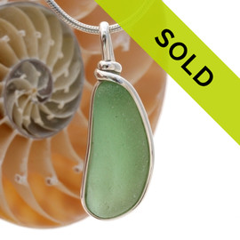 Great piece of natural longer Seaweed Green Genuine Sea glass in my Original Sterling Silver Wire Bezel© a simple design that lets all the beauty of this glass shine.  Sorry this sea glass jewelry piece has been sold!