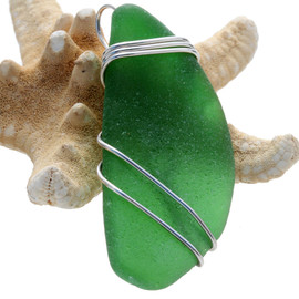 A large perfect piece of vivid green sea glass from the bottom of a bottle set in our triple sterling silver pendant setting.