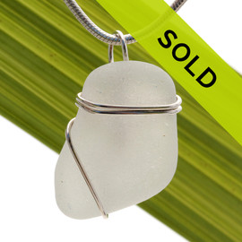 A nice top quality piece of genuine sea glass in white and a simple wire wrapped sterling setting.