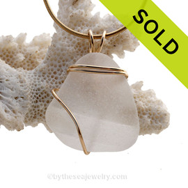 A neat piece of ridged White Genuine Sea Glass in a simple wirewrapped gold pendant setting. Sorry this piece of sea glass jewelry has been sold!