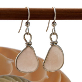 Beautiful peach sea glass pieces from a beach in Nova Scotia are set in our signature sterling silver Original Wire Bezel© setting.