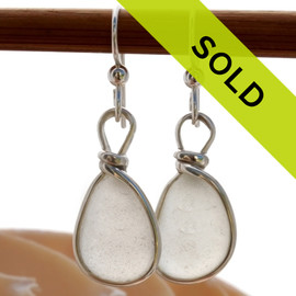 Genuine unaltered sea glass in sterling silver earrings in our Original Wire Bezel© setting. Sorry this sea glass jewelry item has been sold!