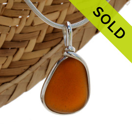 Perfect amber brown natural sea glass piece set in our Original Wire Bezel setting in sterling silver. Shown here on our 2MM snake chain which is available as an upgrade. SOLD - Sorry this Sea Glass Jewelry selection is NO LONGER AVAILABLE!!