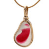 A stunning piece of mixed hot pink and pure white Victorian era sea glass set in gold.