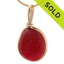 Ultra rare vivid large red sea glass from Seaham England in our Original Wire Bezel© setting in 14K Rolled Gold. Sorry this piece of Sea Glass Jewelry has been SOLD!