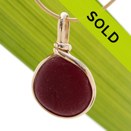 This is an almost perfect piece of opaque red sea glass from England in an elegant 14K goldfilled setting. Sorry this sea glass jewelry piece has been sold!
