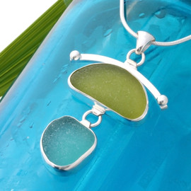 A large piece of lime green sea glass combined with an ultra rare electric aqua and set in fine and sterling silver.