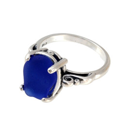 Natural surf tumbled cobalt blue sea glass in a simple sterling scroll ring.
