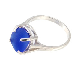 Natural surf tumbled cobalt blue sea glass in a simple sterling basket ring.