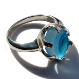 A stunning piece of Victorian Era mixed aqua blue sea glass set in a secure solid sterling prong ring.