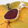 Perfectly set, this red sea glass is encased in silver for a classic look!