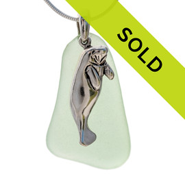 Aqua green natural beach found sea glass is combined with a solid sterling LARGE Florida Manatee charm and presented on an 18 Inch solid sterling snake chain. A  nice sea glass necklace with silver elements. Sorry this sea glass jewelry item has been sold!~