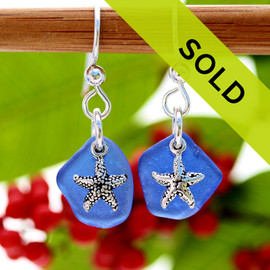 A TOP quality pair of Cobalt Blue Genuine Certified Sea Glass earrings With Starfish Charms. Sorry this pair of sea glass earrings have been sold!