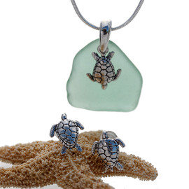 Aqua green sea glass is combined with a solid sterling bail and turtle sterling charms in this lovely sea glass set. Post earrings with comfort clutches finish the set.