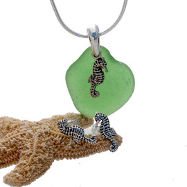 Vivid green sea glass is combined with a solid sterling bail and seahorse sterling charms in this lovely sea glass set. Post earrings with comfort clutches finish the set.