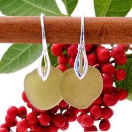 A pair of beach found Sea Glass Earrings in an unusual Khaki Green on Sterling Silver deco hooks.