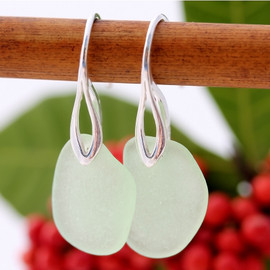 A pair of beach found Sea Glass Earrings in an Seafoam Green on Sterling Silver Deco Hooks.