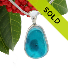 This sea glass is fused vivid teal or turquoise inside a base of  pure white.  It is set in our  sterling silver Deluxe Wire Bezel setting. Very Versatile and elegant. CLASSIC! Sorry this sea glass jewelry piece has been sold!