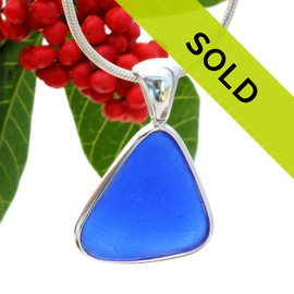 Sorry this sea glass necklace pendant has already been sold! This sea glass a necklace pendant is a Perfect Cobalt Blue. It is set in a solid sterling silver Deluxe Wire Bezel setting. Very Versatile and elegant. CLASSIC!