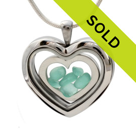 Aqua sea glass heart combined a large silver heart in this sea glass locket necklace. Sorry this sea glass jewelry item has been sold!