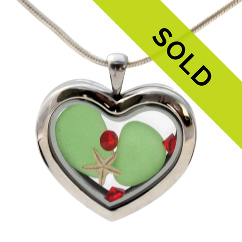 Vivid Green beach found sea glass pieces combined with a real starfish and bright red gems in a feminine heart shaped locket magnetic stainless steel locket necklace!  Sorry this sea glass jewelry item has been sold!