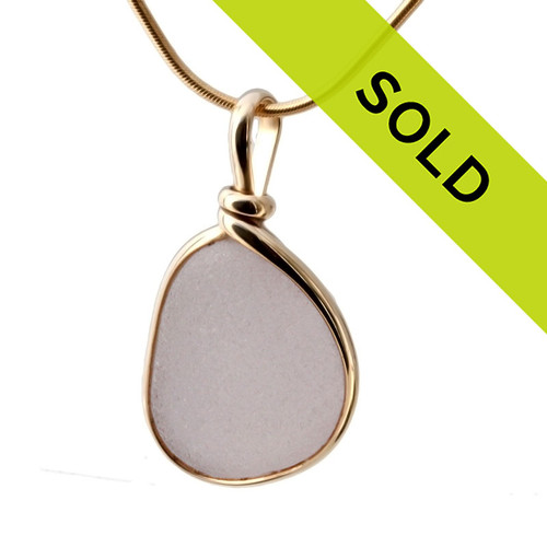 A top quality vivid purple or lavender sea glass from Maine in our Original Wire Bezel Setting© that leaves the sea glass UNALTERED from the way it was found on the beach.  Sorry this sea glass jewelry piece has been sold!