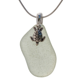 Beach found longer seafoam green sea glass is combined with a solid sterling sea turtle charm and presented on an 18 Inch solid sterling snake chain.