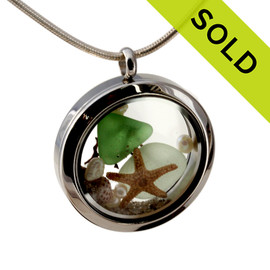 Genuine green and seafoam green sea glass pieces combined with a real starfish, pearls and real beach sand in this 30MM stainless steel locket. Sorry this Sea Glass Jewelry item has been SOLD!