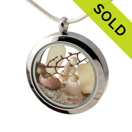 Rare depression pink and yellow sea glass combined with a real starfish, pearls, sea fan, tiny shells and real beach sand in this 30MM stainless steel locket. Sorry this Sea Glass Locket has been SOLD!