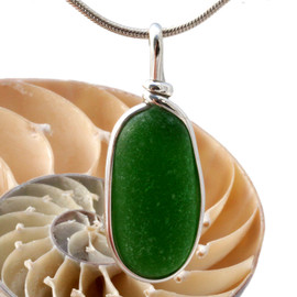 A nice piece of Deep Vivid Green sea glass in an elegant and versatile setting. Our Original Wire Bezel© pendant setting leaves the sea glass totally unaltered from the way it was found on the beach.