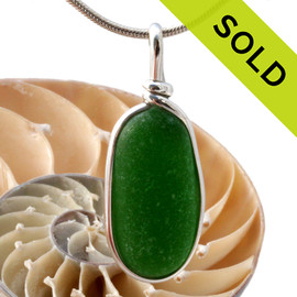 Our Original Wire Bezel© pendant setting leaves the sea glass totally unaltered from the way it was found on the beach. SOLD - Sorry this Sea Glass Pendant is NO LONGER AVAILABLE!