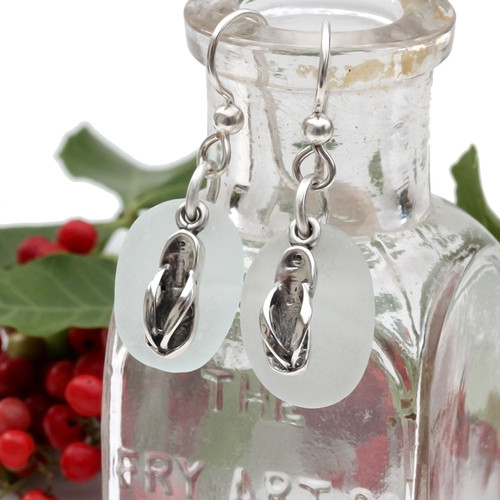 Rounded pure white sea glass earrings in sterling with sterling flip flop charms.