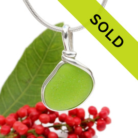 A nice piece of vivid Lime Green or Chartreuse sea glass in an elegant and versatile setting. Our Original Wire Bezel© pendant setting leaves the sea glass totally unaltered from the way it was found on the beach.  Sorry this piece has sold!