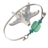 The center bead is handmade by a glass artist and resembles bright green sea glass.