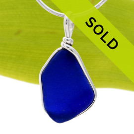 A nice piece of Deep Cobalt Blue with in our signature Original Wire Bezel© pendant setting that leaves both front and back open and the glass unaltered from the way it was found on the beach. Sorry this sea glass jewelry piece has been sold!