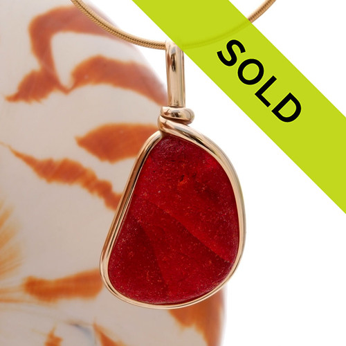 A thick rich Amberina cracked red sea glass piece set in our Original Wire Bezel© pendant setting. Sorry this ULTRA RARE sea glass jewelry piece has already been sold!