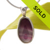 This ultra rare Seaham sea glass multi color purple and pink necklace pendant is set in our Deluxe Wire Bezel© pendant setting.