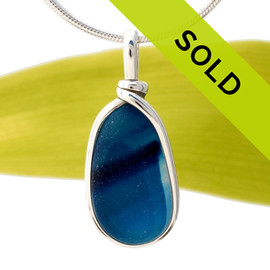Mixed royal blue English sea glass set in a solid sterling silver Original Wire Bezel© pendant.