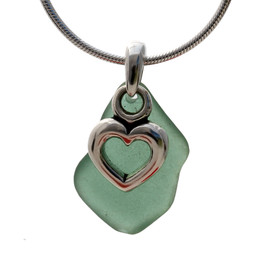A perfect piece of natural green sea glass set on a solid sterling hand cast bail with a sterling silver heart charm. A great sea glass necklace for any sea glass lover!