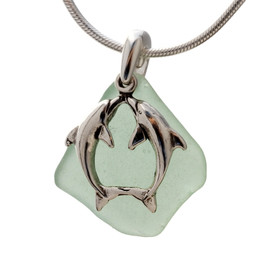 A stunning piece of seafoam green GENUINE sea glass pendant with a LARGE SOLID STERLING kissing dolphins charm.