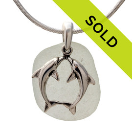 A stunning piece of perfect white GENUINE sea glass pendant with a LARGE SOLID STERLING kissing dolphins charm. Sorry this sea glass jewelry item is not available.