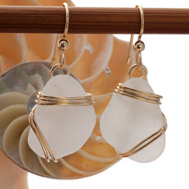 Perfect natural triangles of pure white sea glass set in our triple rolled 14K gold setting.