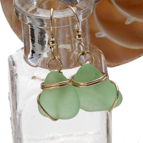 Vivid yellowy seafoam green sea glass earrings in a simple gold setting.